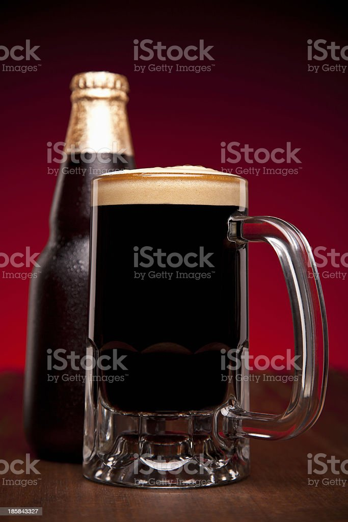 Glass and bottle of beer royalty-free stock photo