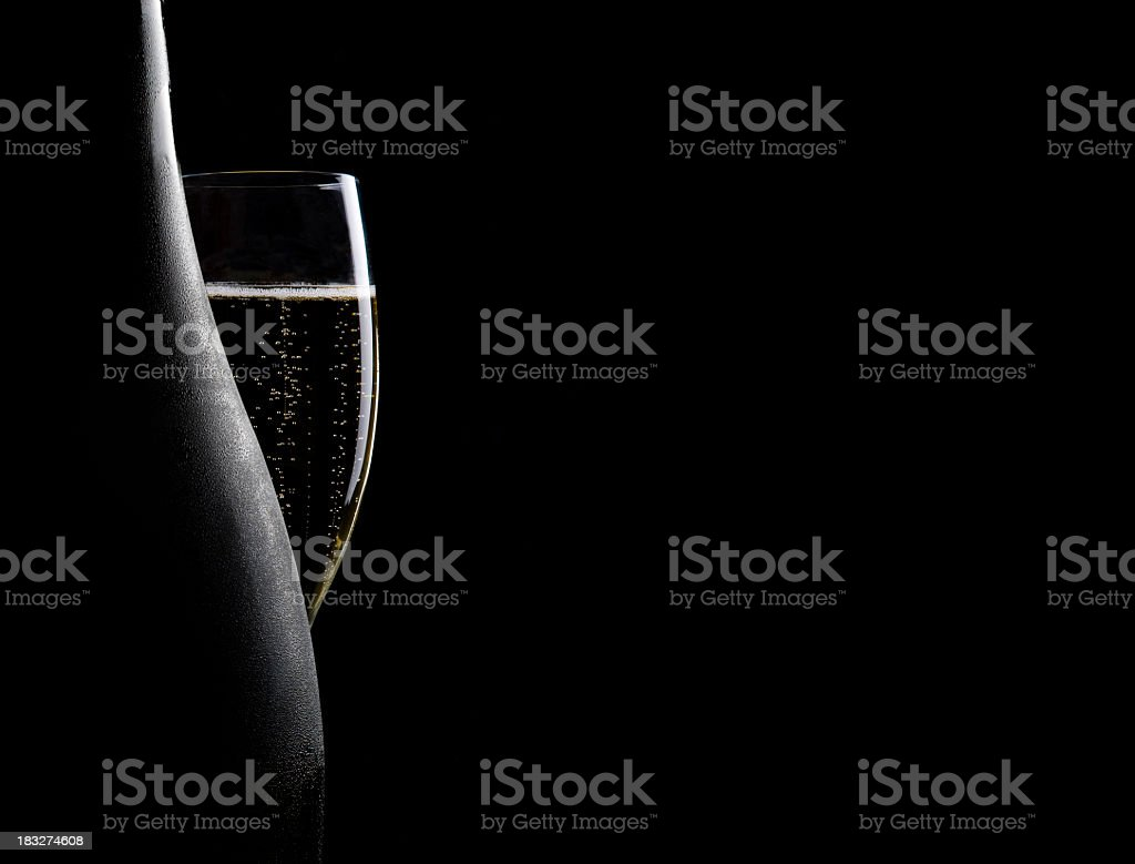 Glass and bottle of champagne stock photo