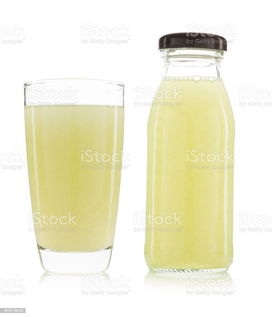 Glass and bottle of guava juice isolated stock photo