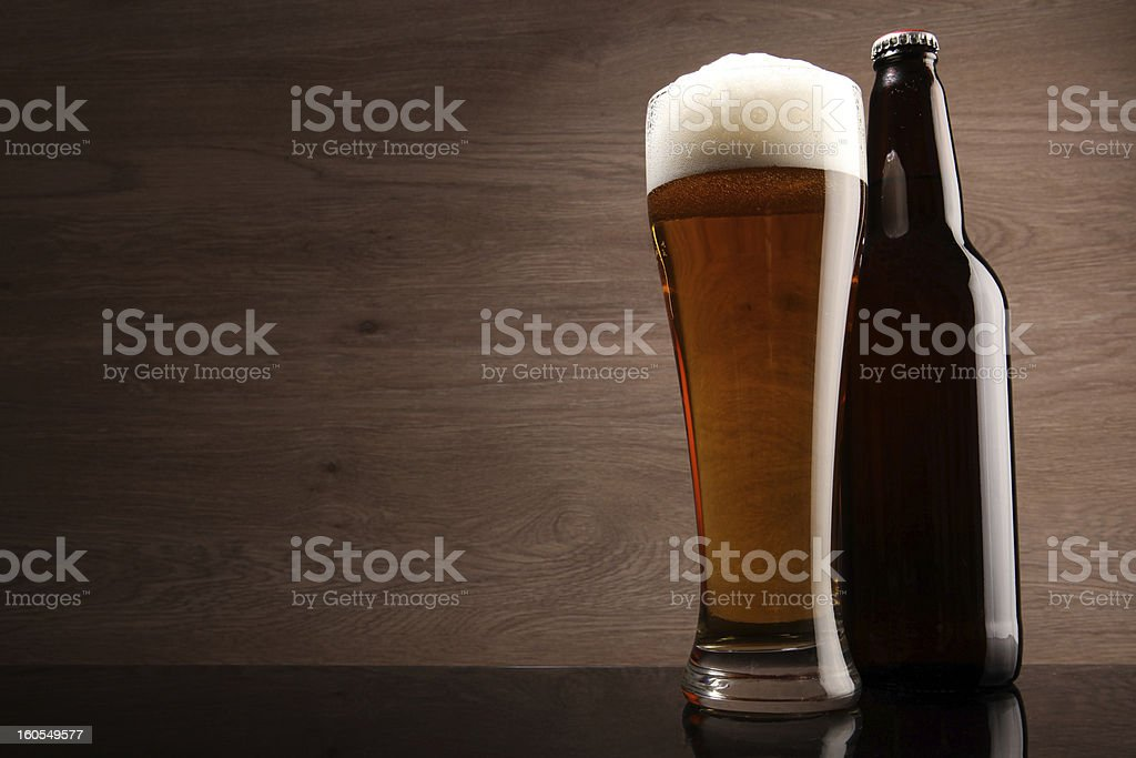 Glass and bottle with beer royalty-free stock photo