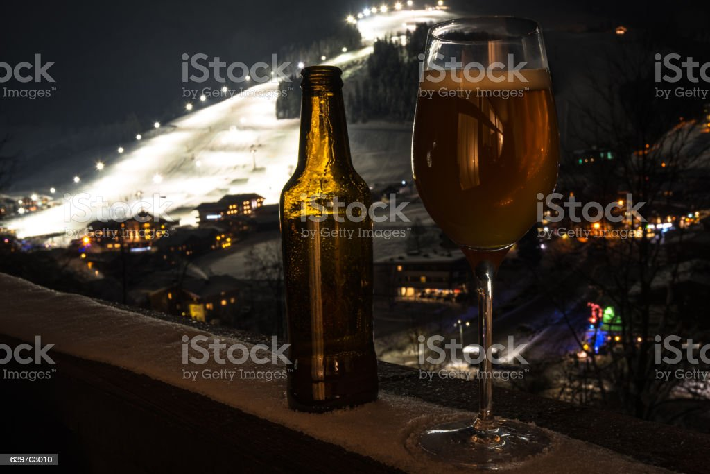 Glass and bottle with craft beer on a balcony at stock photo