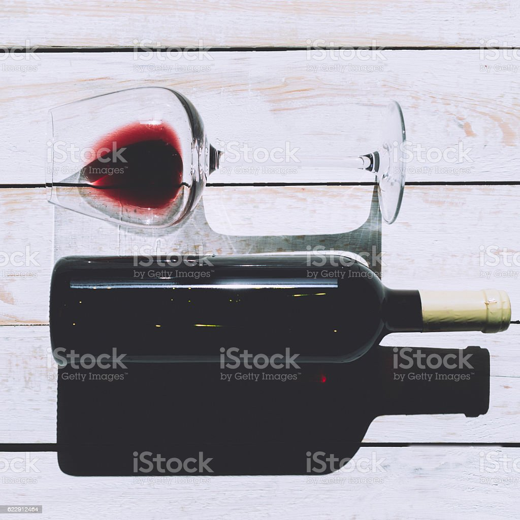 Glass and bottle with red wine stock photo