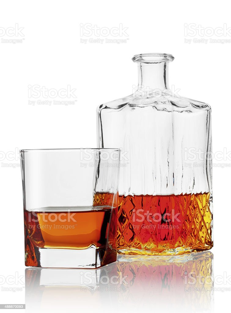 Glass and carafe of cognac stock photo
