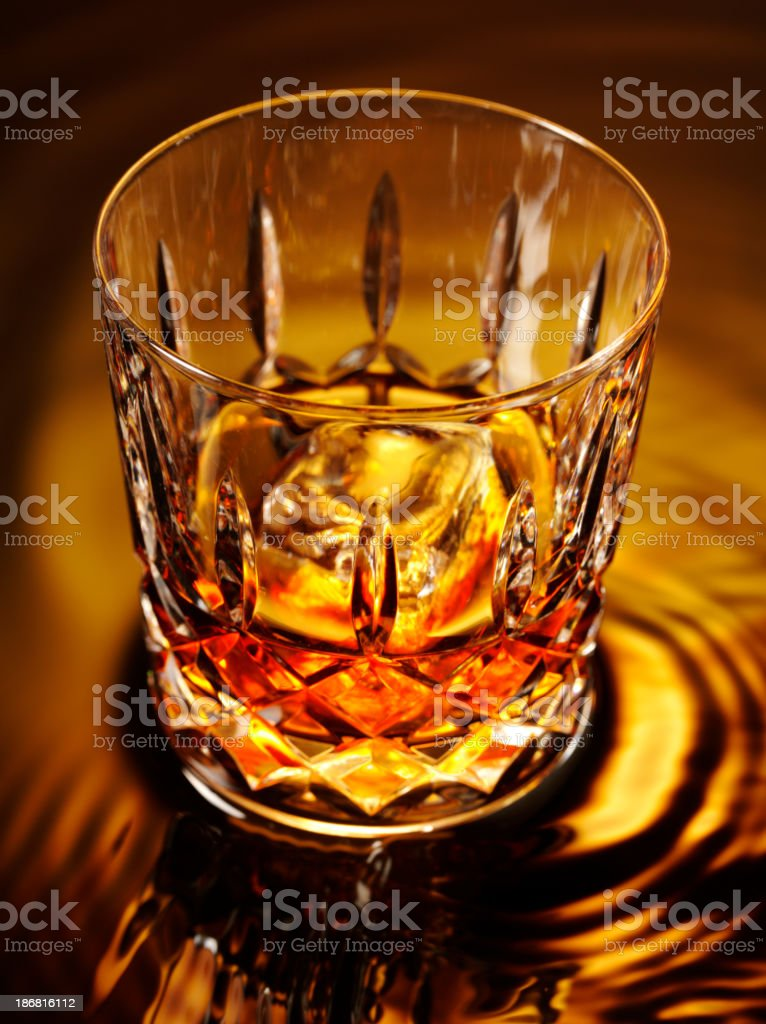 Glass and Whiskey royalty-free stock photo
