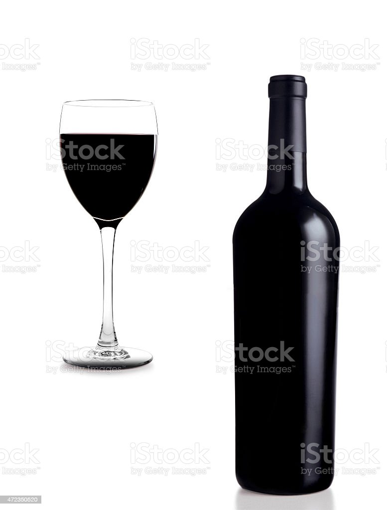 Glass and wine with bottle stock photo