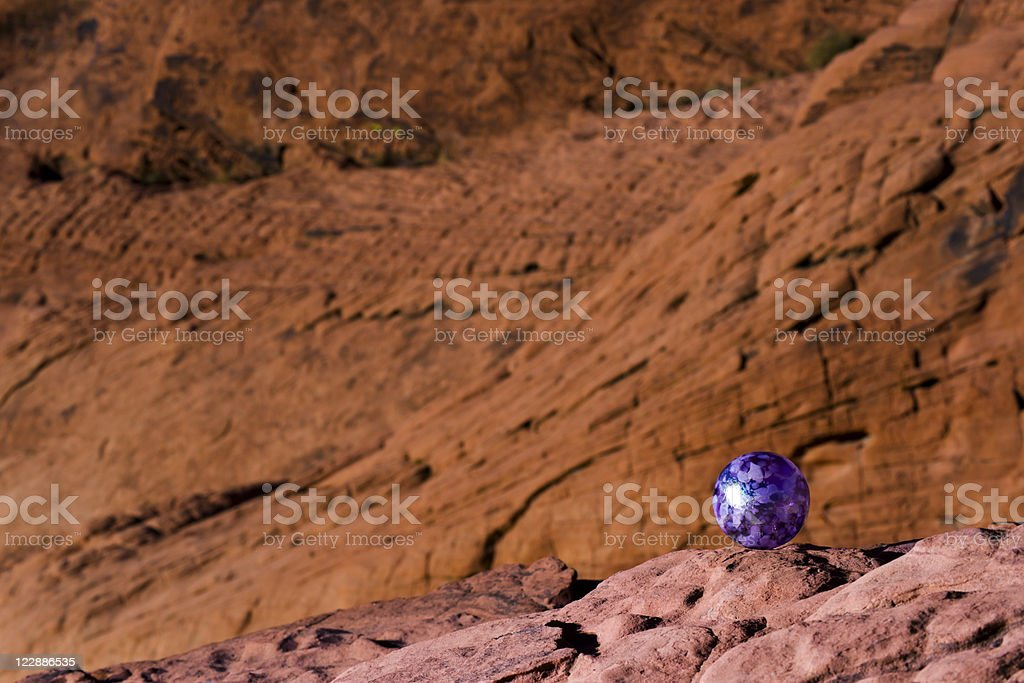 Glass Ball and Sandstone Cliffs royalty-free stock photo