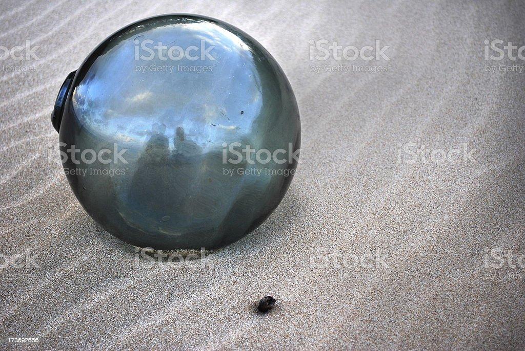 Glass Ball on Sand stock photo