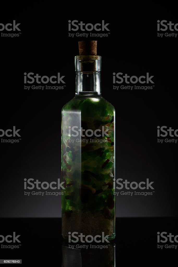 Glass beach in a bottle stock photo