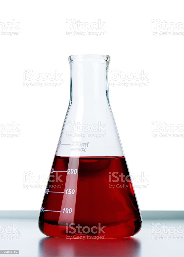 Glass beaker filled half way with a red liquid stock photo
