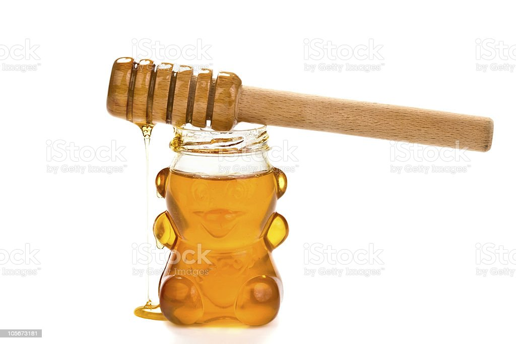 Glass bear with honey inside royalty-free stock photo