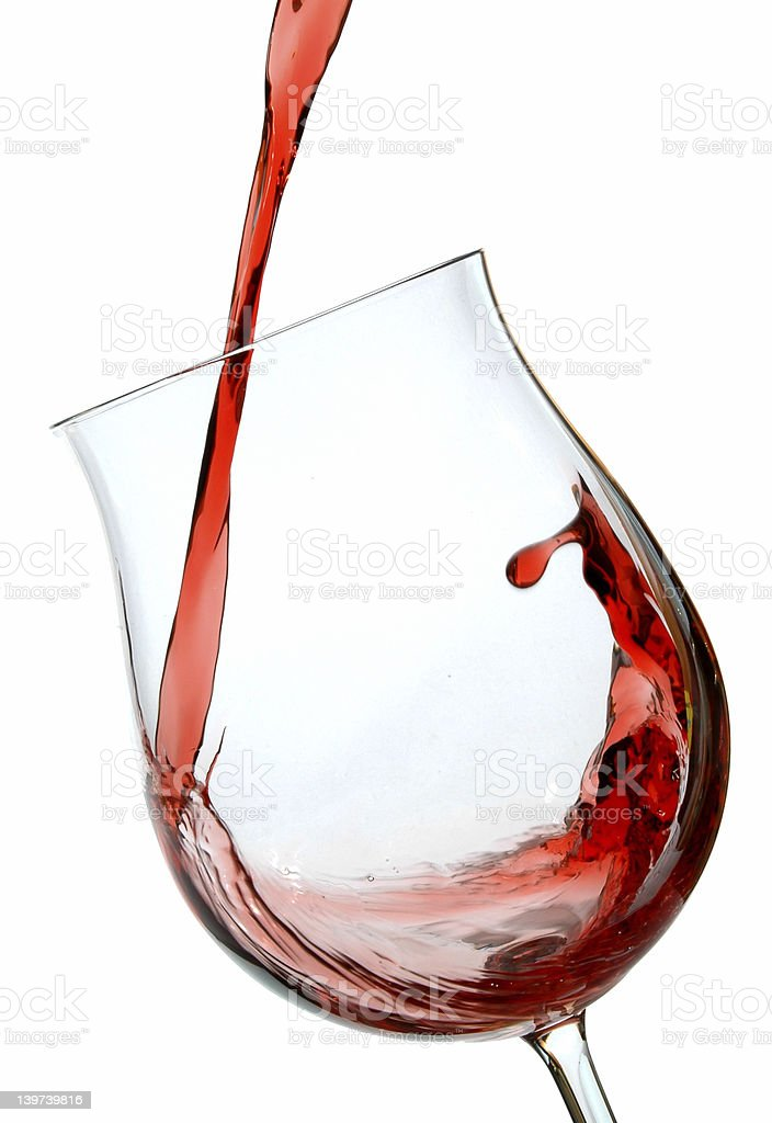 A glass being filled with red wine  royalty-free stock photo