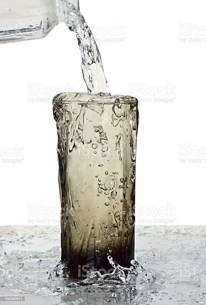 Glass being overflown with water stock photo