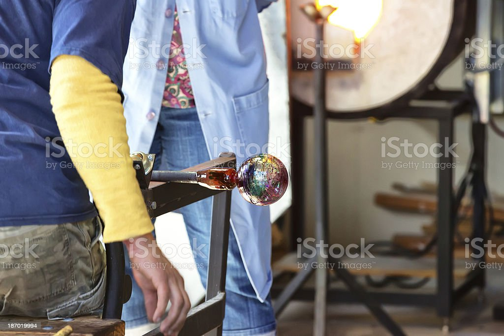Glass blower demonstrates for a tourist royalty-free stock photo