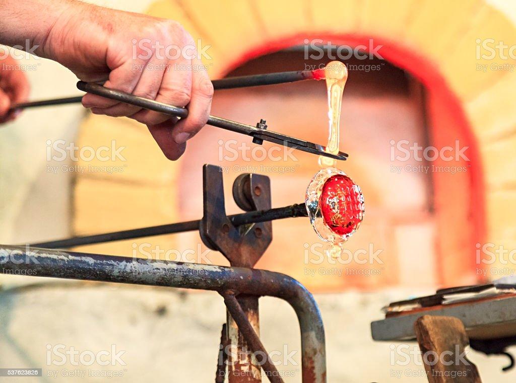 Glass blower hands stock photo