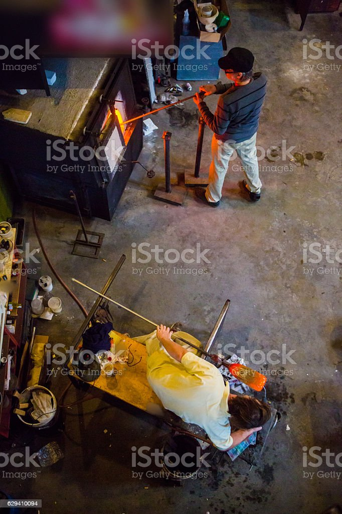 Glass blowers Working in Studio stock photo