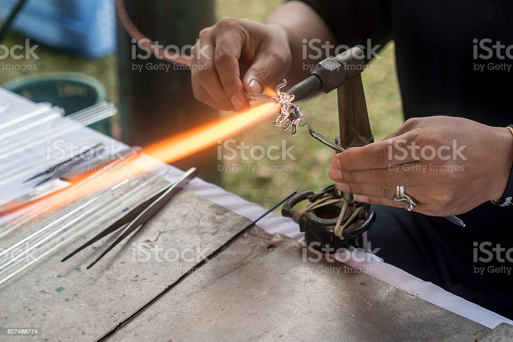 glass blowing Crafts elephant fire stock photo