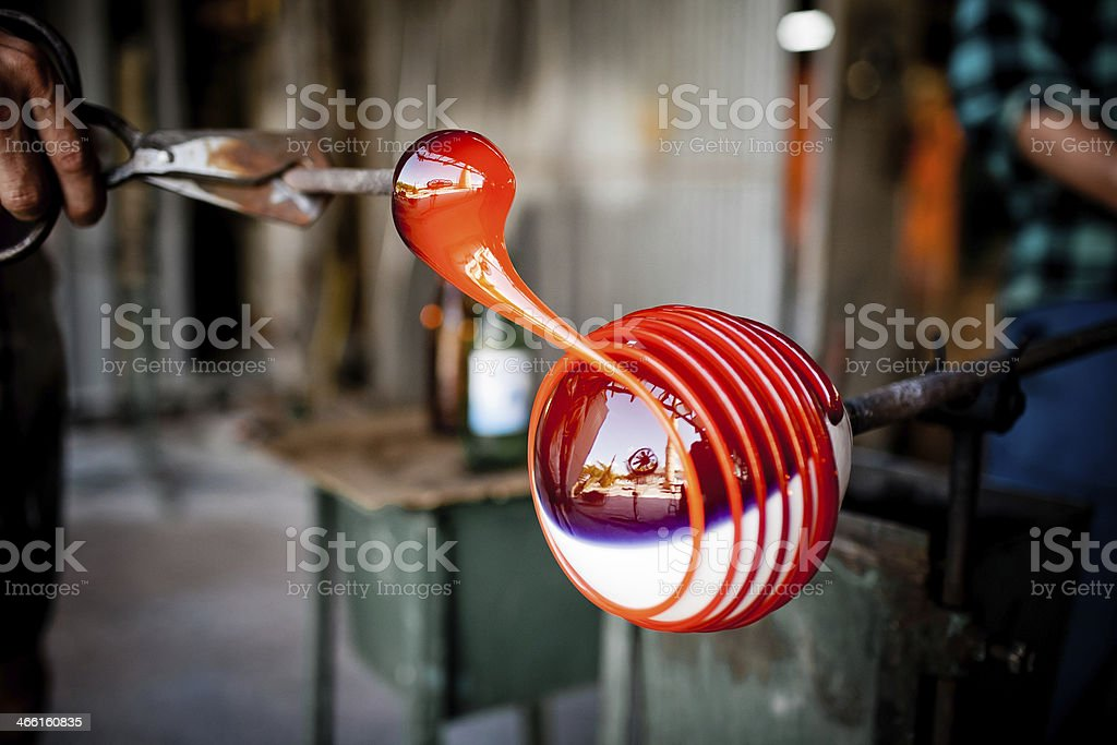 glass blowing in factory stock photo
