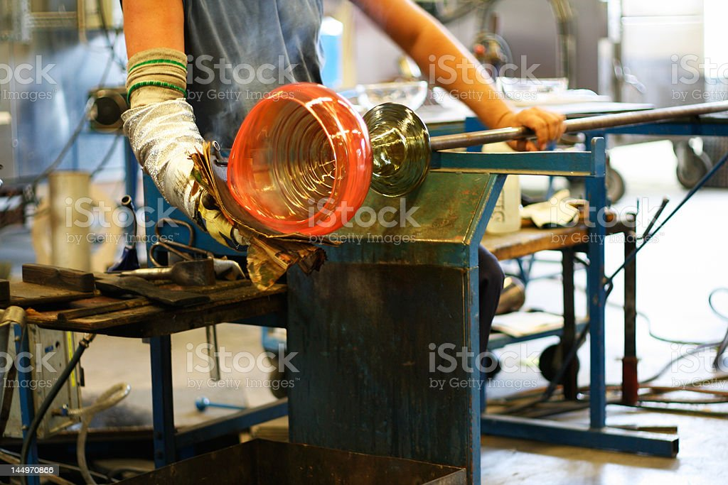 Glass blowing - shaping a vase stock photo
