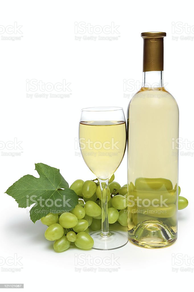 Glass, bottle and grape cluster royalty-free stock photo