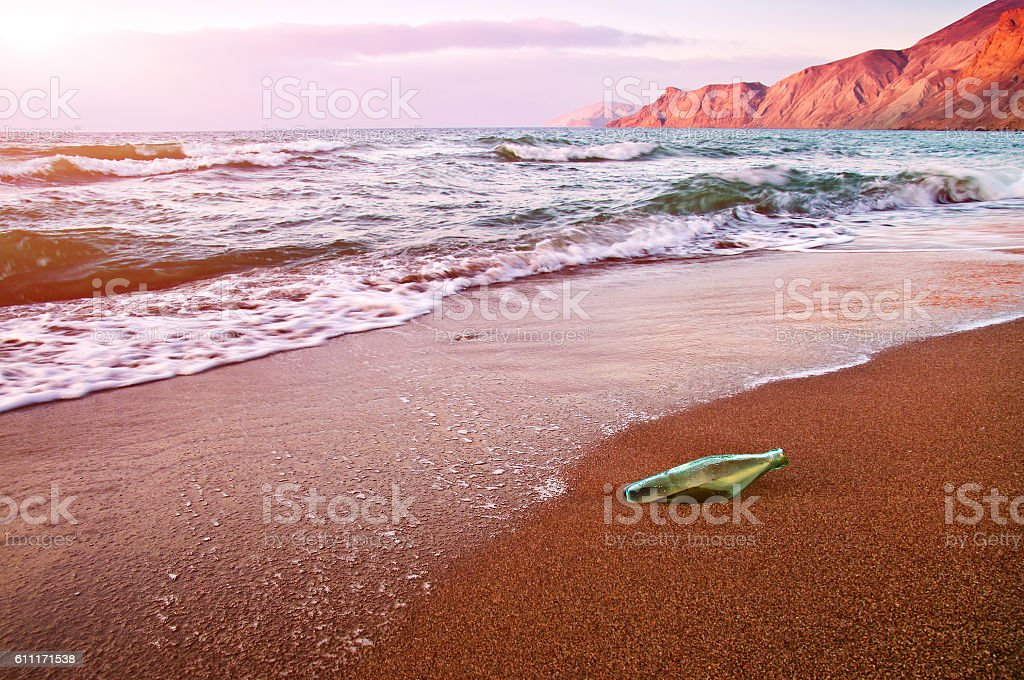 glass bottle, beach stock photo