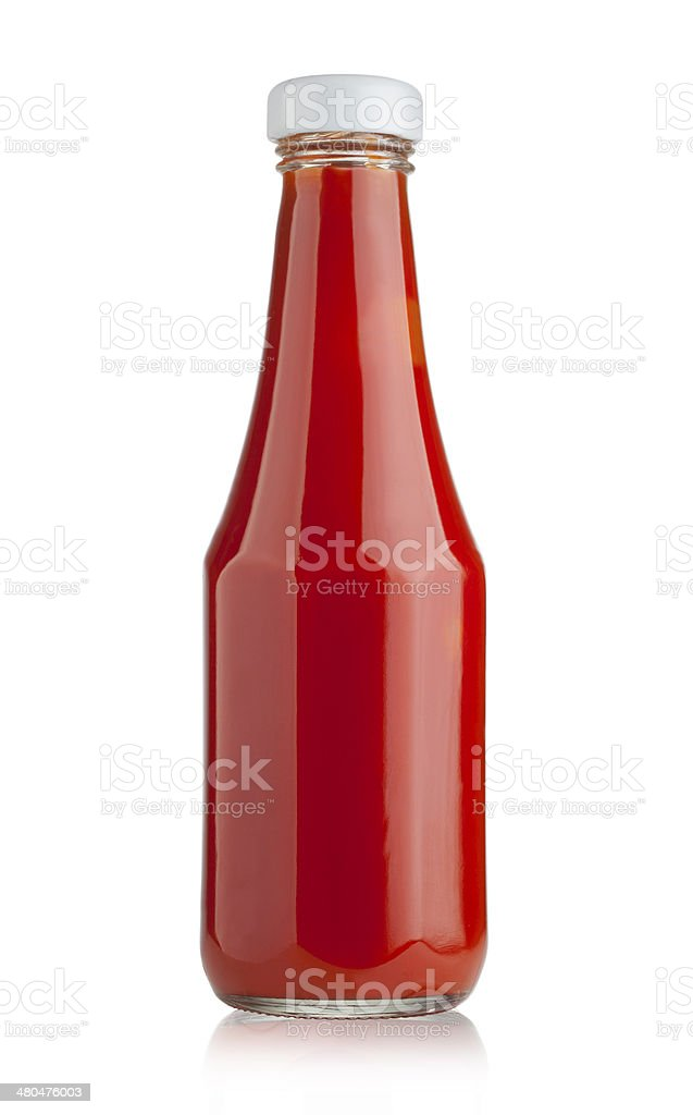 Glass bottle of ketchup stock photo
