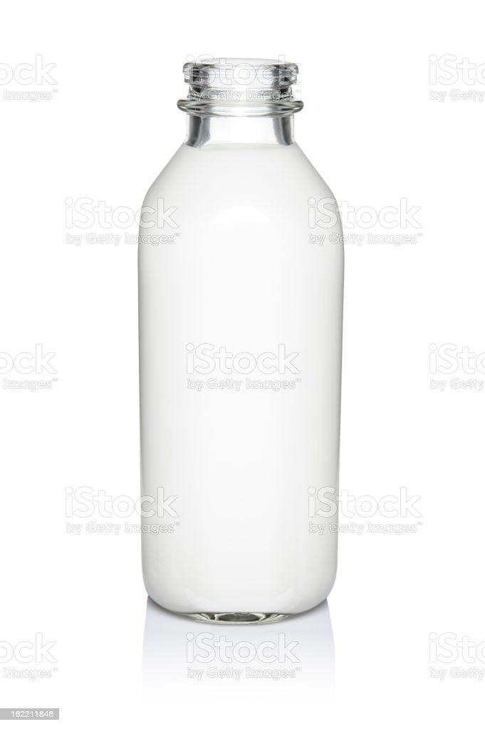 A glass bottle of milk against a white background stock photo