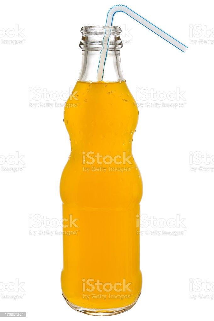Glass bottle of orange soda with straw royalty-free stock photo