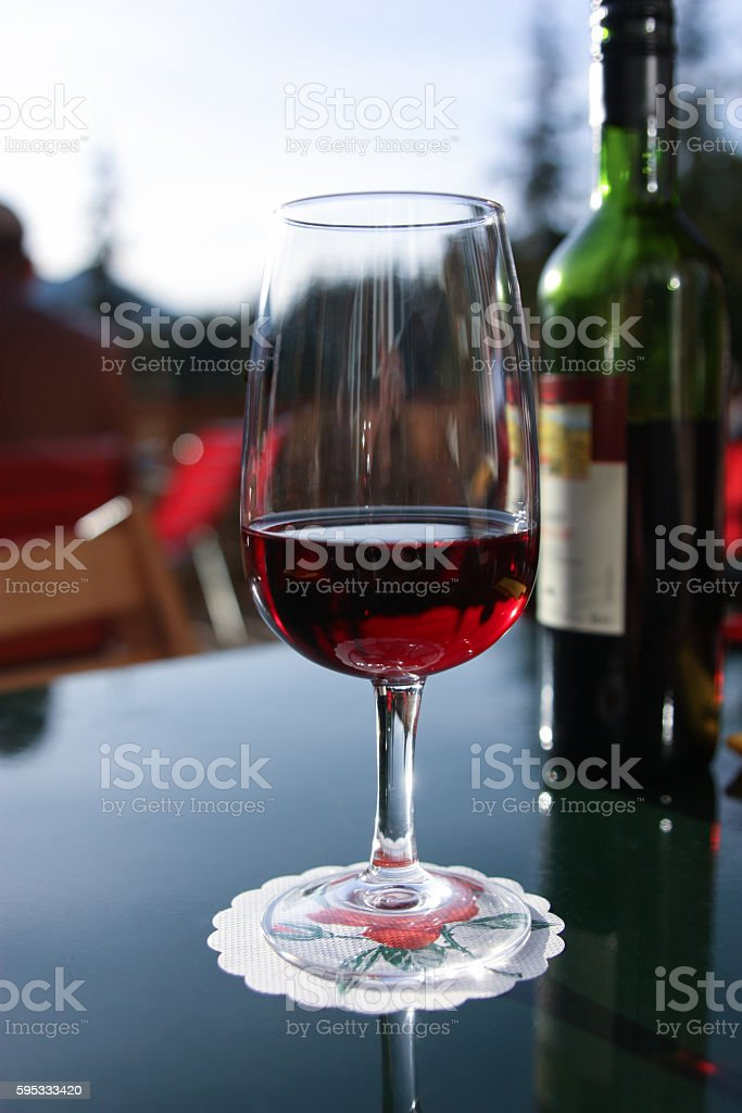 Glass bottle of red wine and the background. stock photo