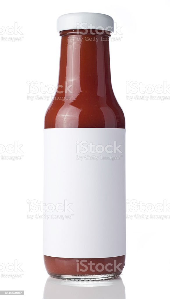 Glass bottle of tomato ketchup with a blank label stock photo