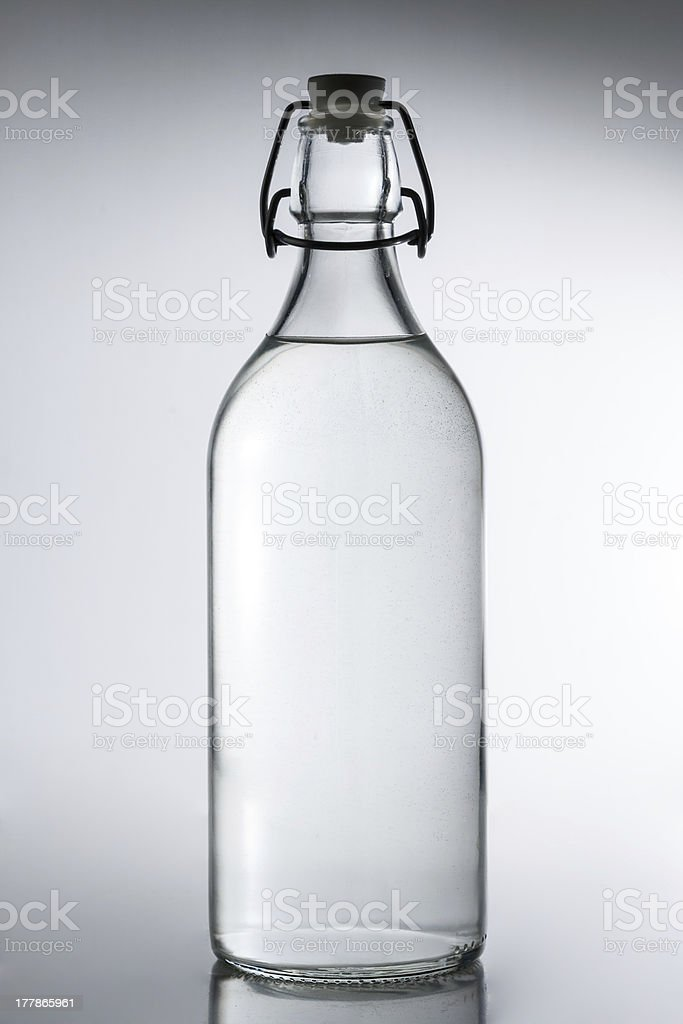 Glass bottle of water royalty-free stock photo