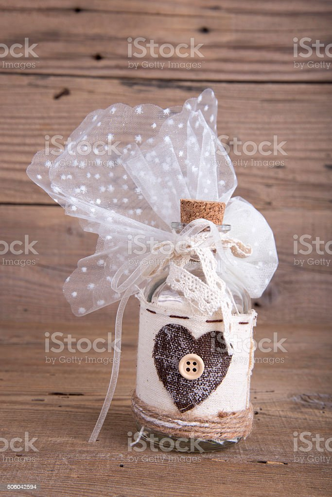 Glass bottle wedding favor christening stock photo