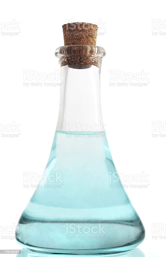 glass bottle with blue liuqid royalty-free stock photo