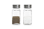 glass bottle with ground pepper and salt