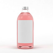 Glass bottle with liquid on white background.