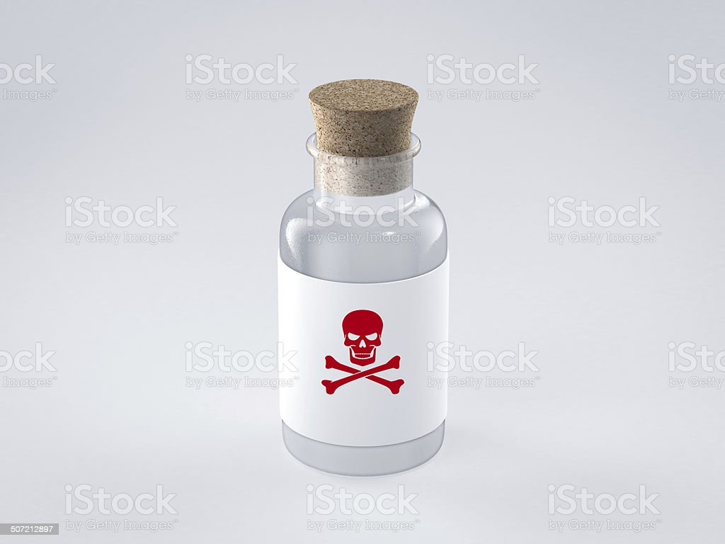 glass bottle with poison label stock photo