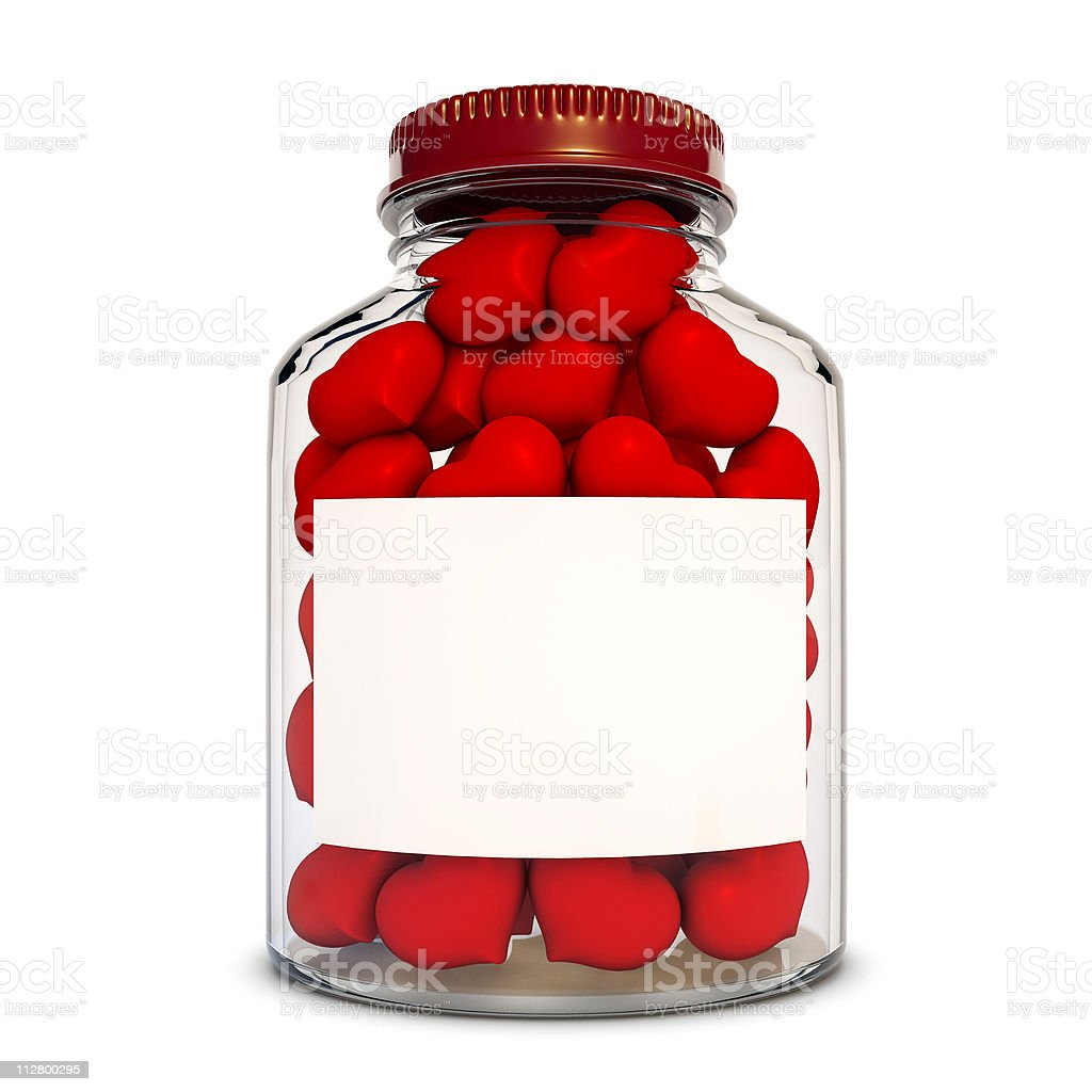 Glass bottle with red hearts royalty-free stock photo