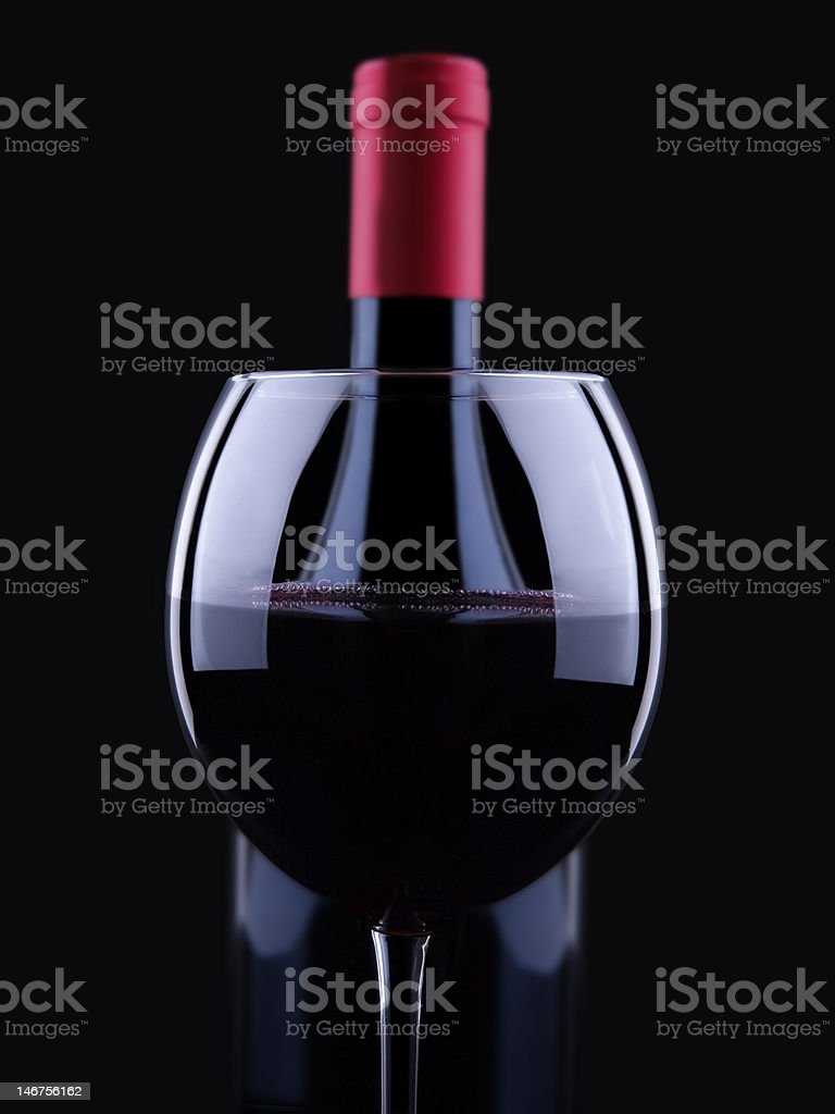 glass bottle with red wine stock photo