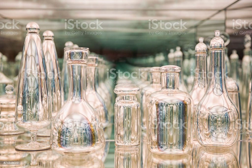 Glass bottles are reflected in the mirror stock photo