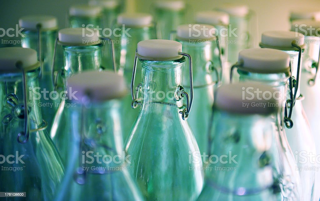 Glass bottles lit from behind royalty-free stock photo