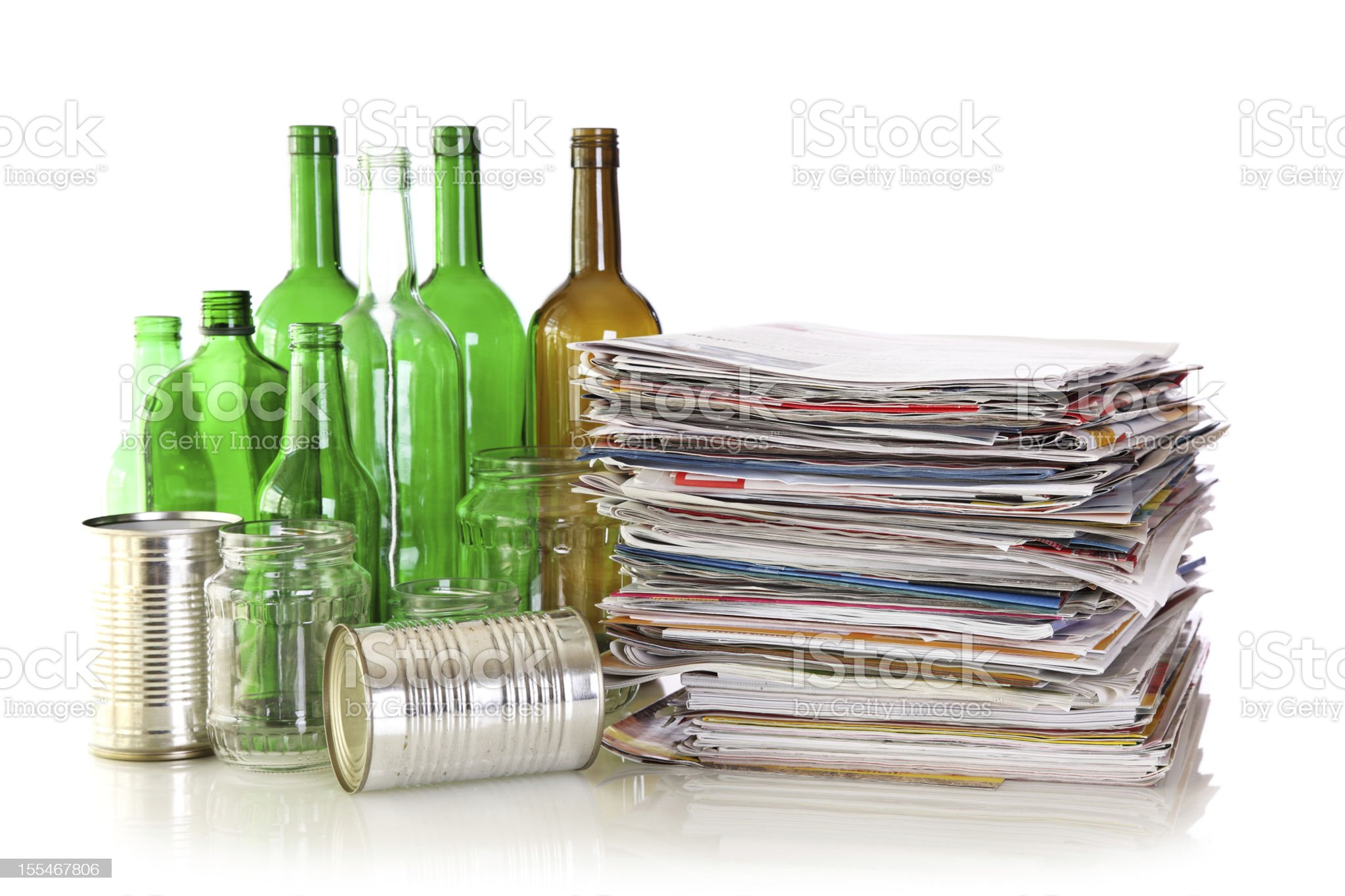 Glass bottles, metal cans and newspapers royalty-free stock photo