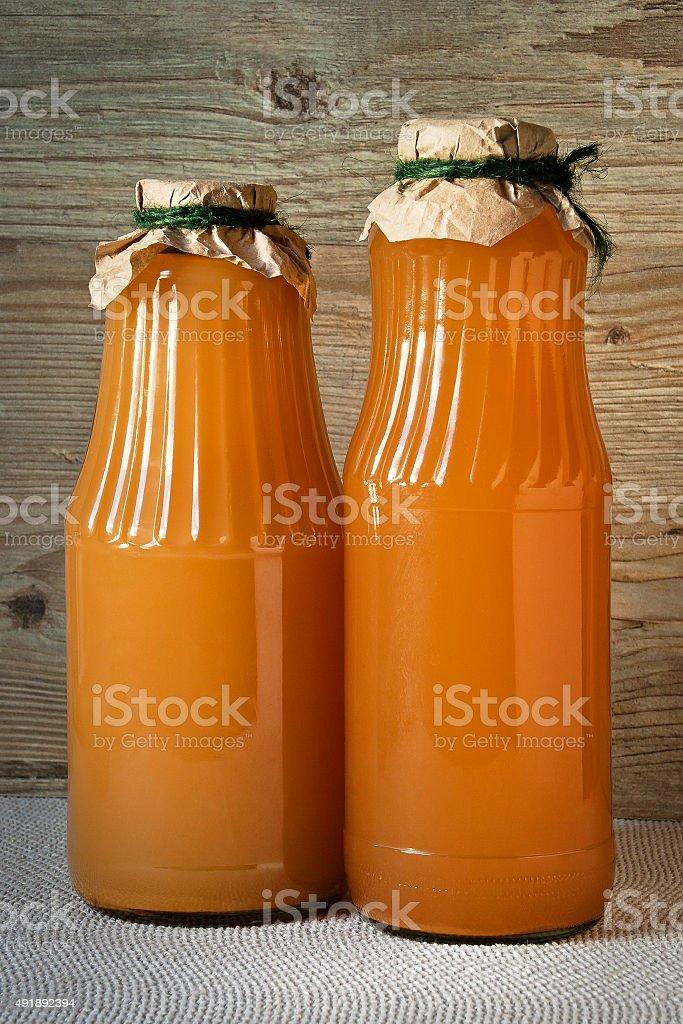 Glass bottles of juice stock photo