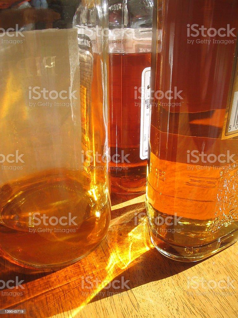 Glass Bottles of Whiskey royalty-free stock photo