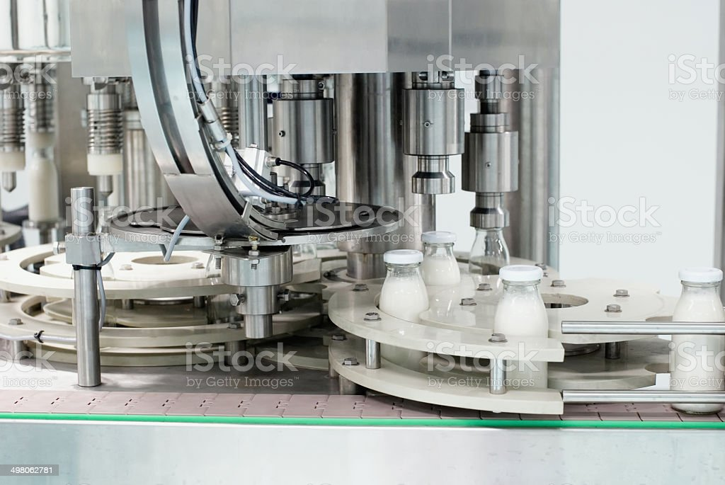 Glass bottles on the conveyor belt stock photo