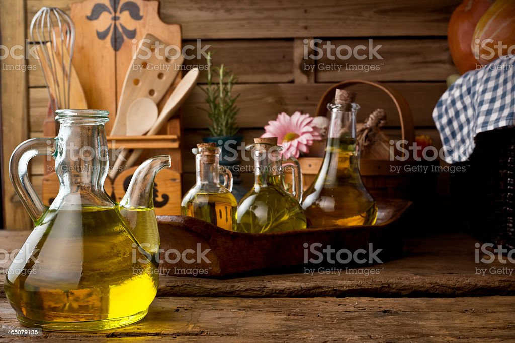 Glass bottles with olive oil stock photo