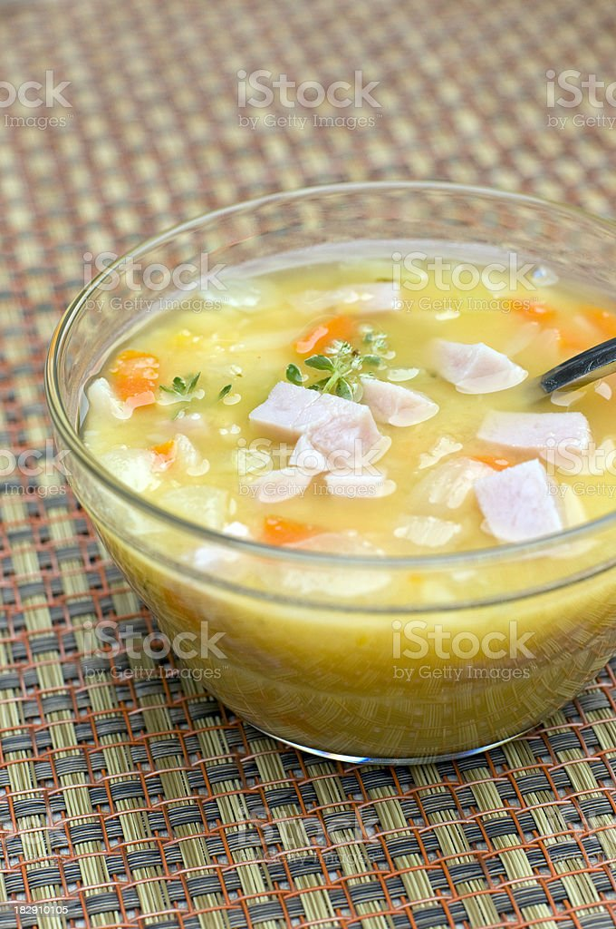 Glass bowl of split pea soup stock photo