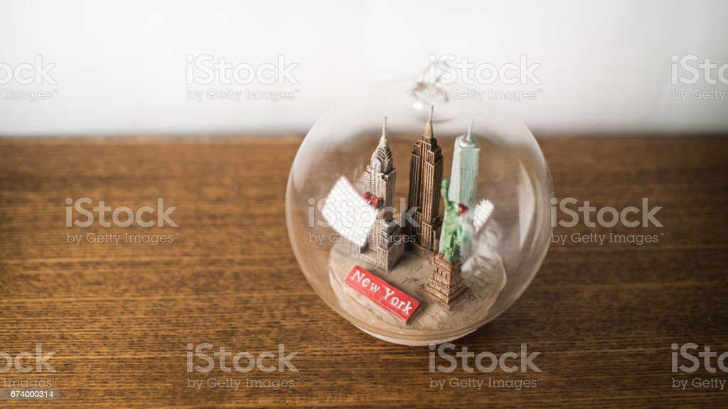 glass bowl with buildings inside on a white background stock photo