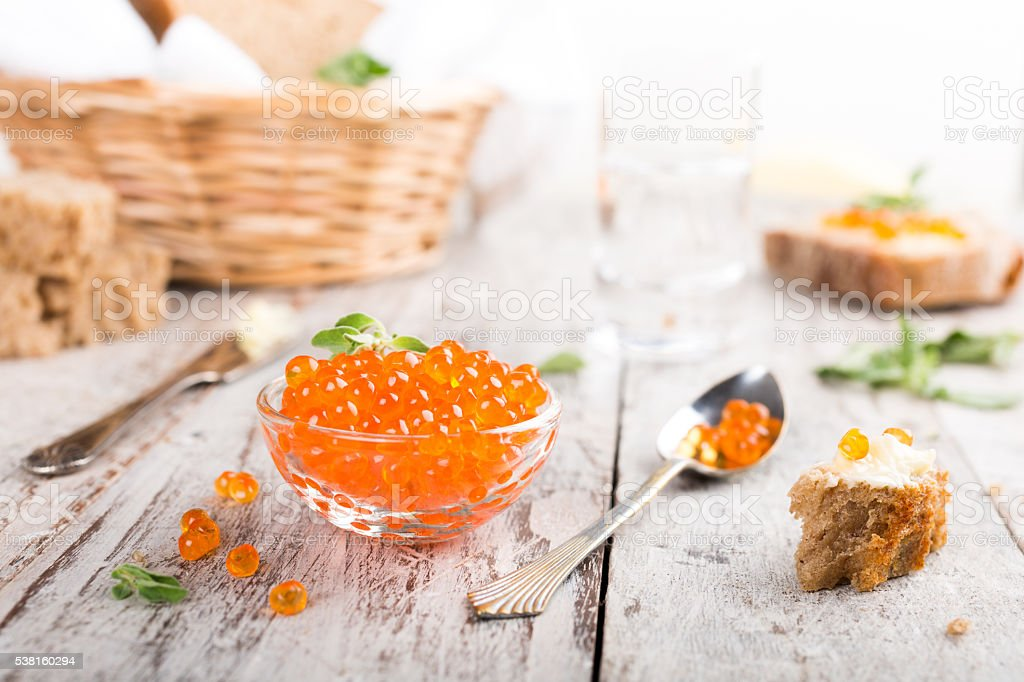 Glass bowl with red caviar stock photo