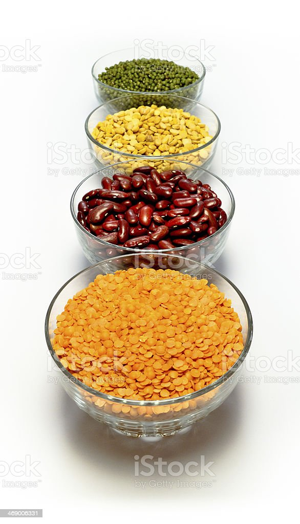 Glass bowls filled with lentils and pulses. stock photo