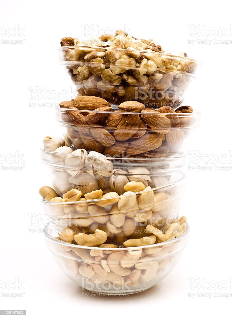 Glass bowls with almonds, cashew nuts, pistachios, peanuts stock photo