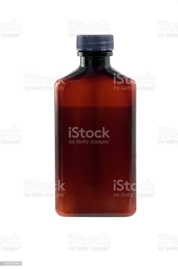 Glass brown bottle with cap stock photo
